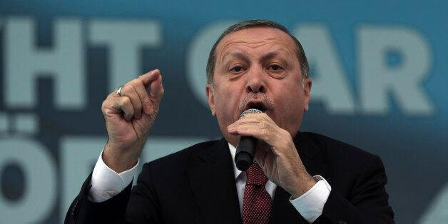 Turkey's President Recep Tayyip Erdogan addresses his supporters during a ceremony for a new train station...