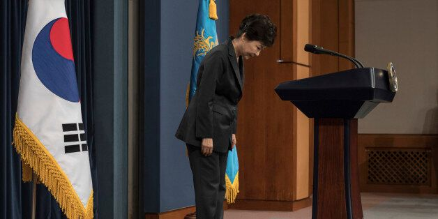 FILE - In this Friday, Nov. 4, 2016 file photo, South Korean President Park Geun-hye bows before addressing...
