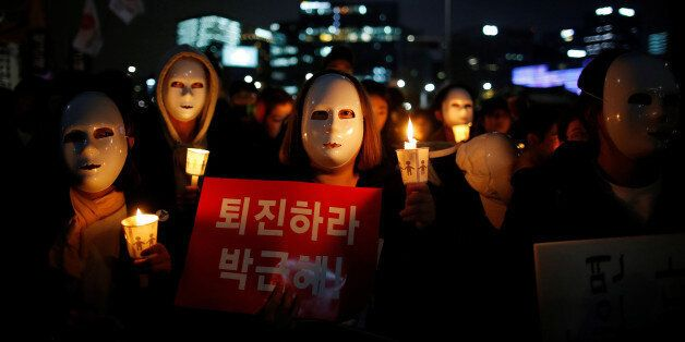 People march toward the Presidential Blue House during a rally calling for President Park Geun-hye to...
