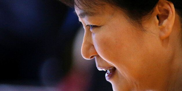 South Korea's President Park Geun-hye smiles as she attends the ASEAN plus South Korea meeting during...
