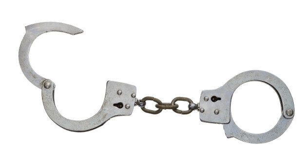 A set of handcuffs, isolated on