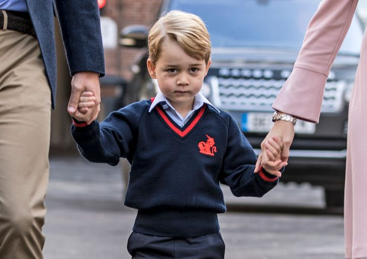 A solemn Prince George of Cambridge arrives for his first day of school at Thomas's Battersea on Sept. 7, 2017.