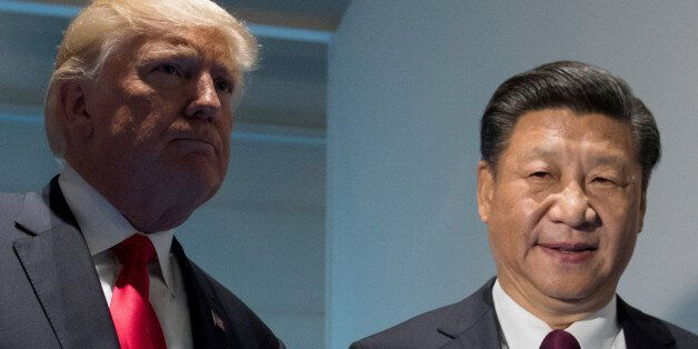 U.S. President Donald Trump and Chinese President Xi Jinping (R) meet on the sidelines of the G20 Summit...