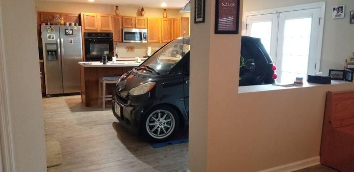 Florida Man Parks Smart Car In Kitchen