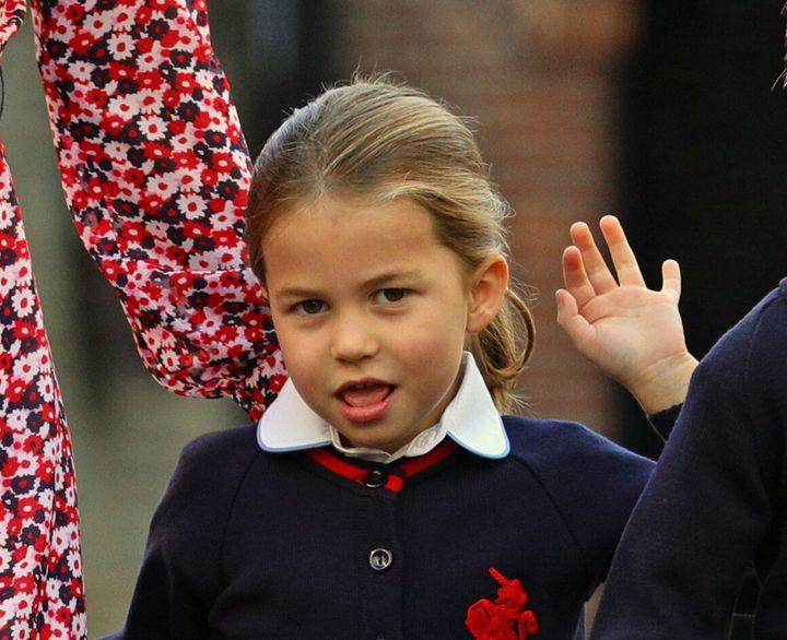 Princess Charlotte waving as she heads to school.