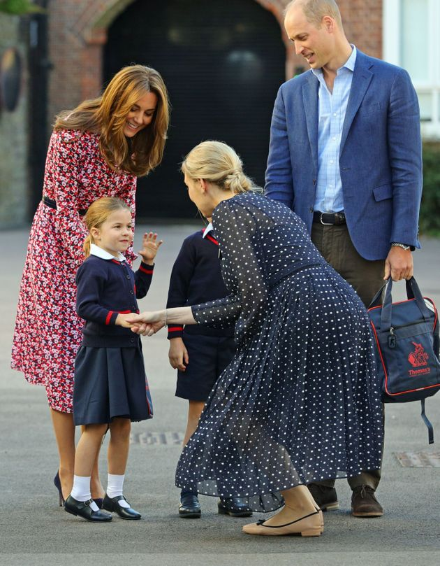 Charlotte is greeted by Helen Haslem, head of the lower school, on her arrival for her first day of school...