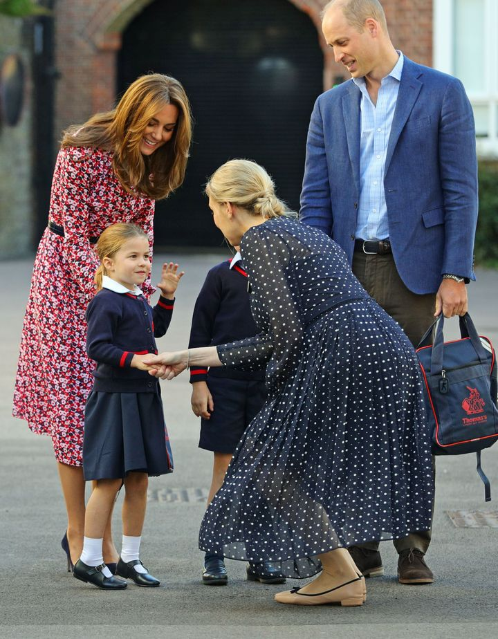 Charlotte is greeted by Helen Haslem, head of the lower school, on her arrival for her first day of school at Thomas's Batter