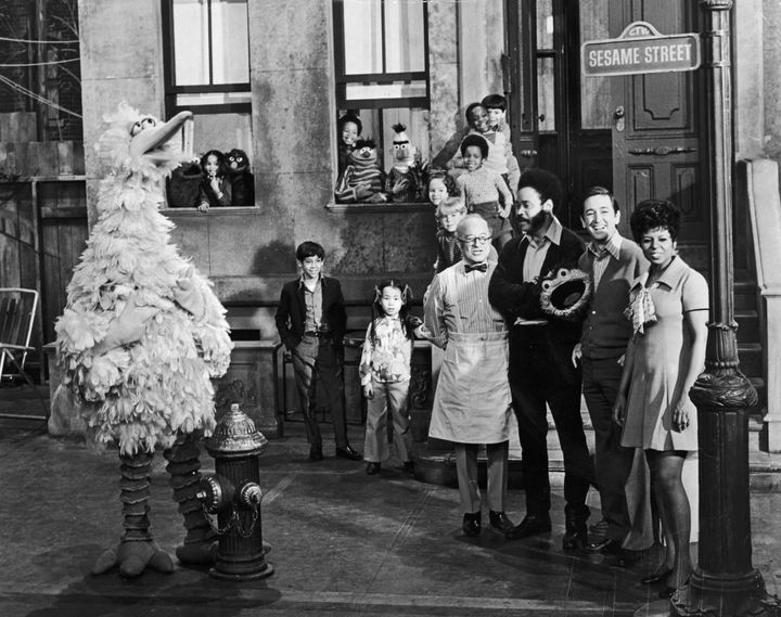 Sesame Street cast members posing on the set with some of the puppet characters and children, circa 1969. Left to right: Will