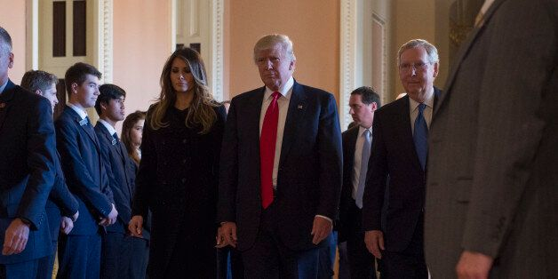 President-elect Donald Trump and his wife Melania walk with Senate Majority Leader Mitch McConnell of...