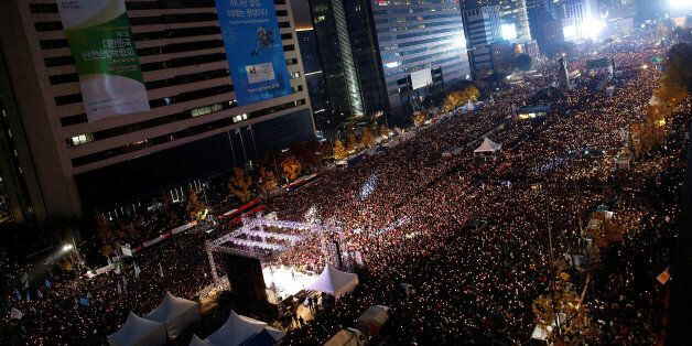 People take part in a rally calling for President Park Geun-hye to step down in central Seoul, South...
