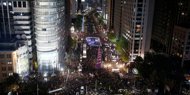 Protesters take part in a protest denouncing South Korea's President Park Geun-hye over a recent influence-peddling...