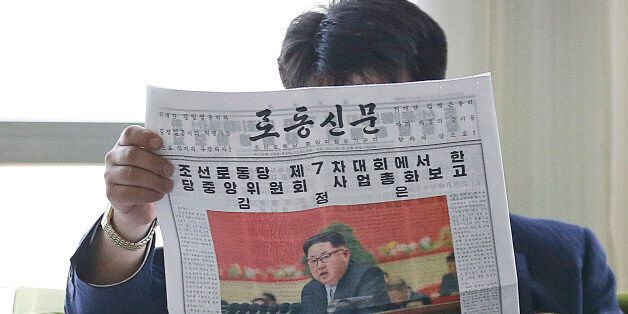 A North Korean man reads a local newspaper with an image of leader Kim Jong Un Sunday, May 8, 2016, in...