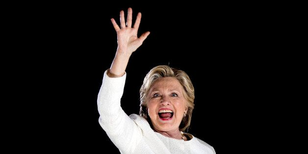 Democratic presidential candidate Hillary Clinton waves after speaking at a rally at Sanford Civic Center...