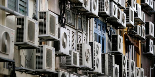 Rows of air conditioners are seen on the walls of a building in Singapore's financial district December...