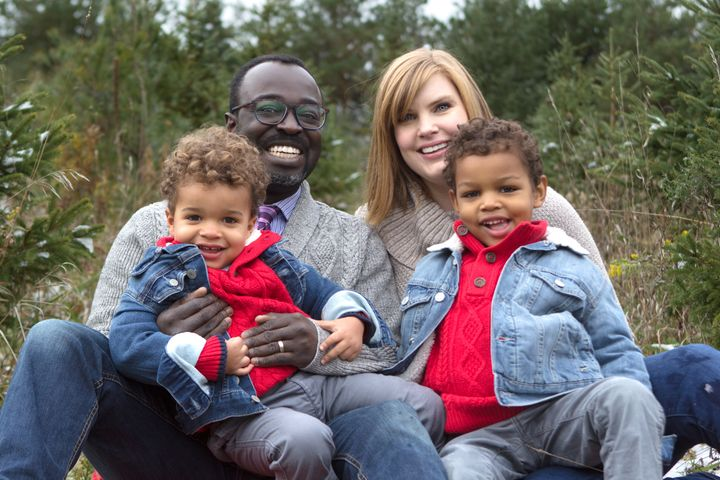 Palmer's eldest son is already aware that his mom is white and his dad is black, but he's still learning exactly what that means. (Pictured: Casey Palmer with his wife and kids)