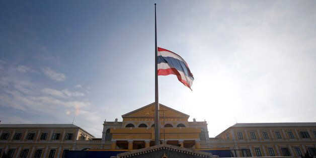 The Thai national flag flutters at half mast at the Ministry of Defence following the passing of King...