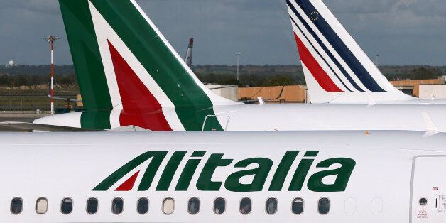 In this photo taken on Nov. 4, 2013 Alitalia, left, and Air France, right, planes are parked on the tarmac...