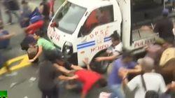 경찰차로 시위대를 깔아뭉갠 필리핀의 반미 시위