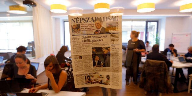 A copy of the last issue of the leftist newspaper Nepszabadsag, which was unexpectedly shut down on Saturday...