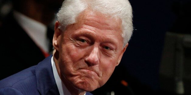Former U.S. President Bill Clinton arrives at the presidential town hall debate between Republican U.S....