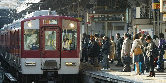 JAPAN - FEBRUARY 05: Commuters stand on the station platform at Kintetsu Corp.'s Tsuruhashi station in...