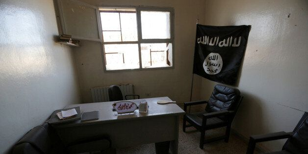 A view shows an office that was used by Islamic State militants in Turkman Bareh village, after rebel...