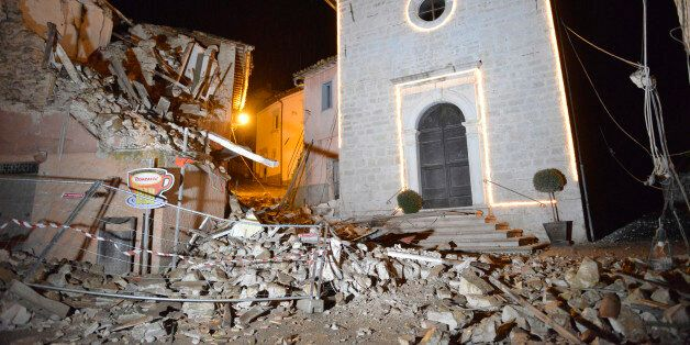 The Church of San Sebastiano stands amidst damaged houses in Castelsantangelo sul Nera, Italy, Wednesday,...
