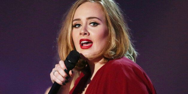 FILE - In this Feb. 24, 2016 file photo shows Adele onstage at the Brit Awards 2016 at the 02 Arena in...
