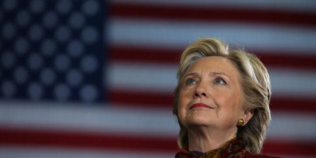 U.S. Democratic presidential nominee Hillary Clinton attends a campaign rally accompanied by vice presidential...