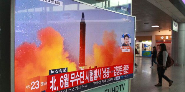 A TV screen shows a file image of a missile launch conducted by North Korea in a local news program,...