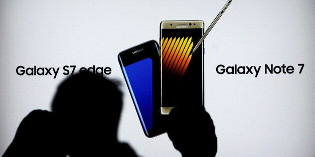 Shoppers walk near a Galaxy Note 7 advertisement at a Samsung store in Jakarta, Indonesia, October 14,...