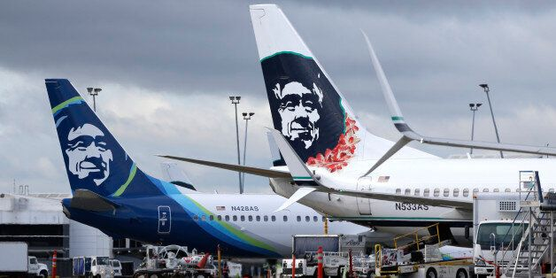 FILE - In this Monday, April 4, 2016, file photo, Alaska Airlines planes with the company's new livery...