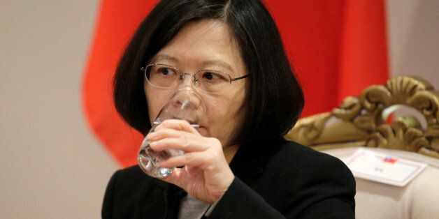 Taiwan's President Tsai Ing-wen drink water during an interview in Luque, Paraguay, June 28, 2016. REUTERS/Jorge