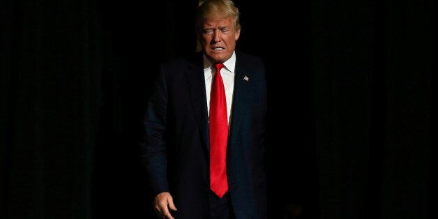 Republican U.S. presidential nominee Donald Trump walks on stage at a campaign rally in West Palm Beach,...
