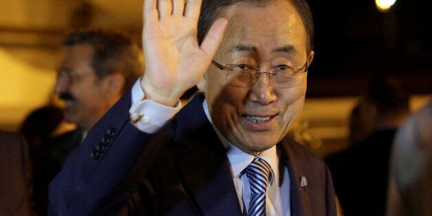 United Nations Secretary-General Ban Ki-moon waves to the media during his arrival at Jose Marti international...