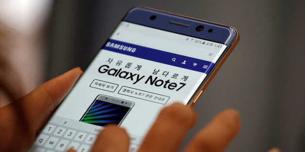 A visitor tries out a Samsung Electronics' Galaxy Note 7 at company's headquarters in Seoul, South Korea,...