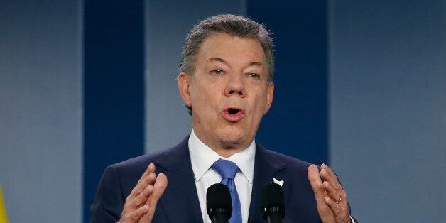 FILE - In this Wednesday, Oct. 4, 2016 file photo, Colombia's President Juan Manuel Santos delivers...