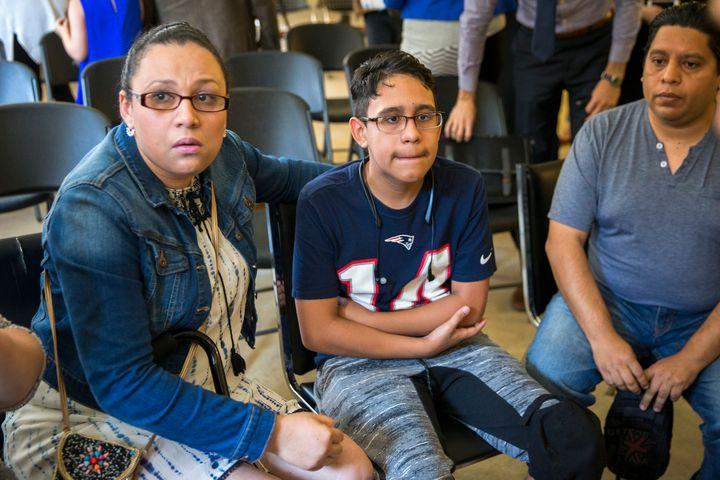 BOSTON, MA - AUGUST 26: Mariela Sanchez of Tegucigalpa, Honduras, left, her son Jonathan Sanchez, 16, and husband Gary Sanche