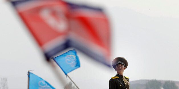 In this Sept. 24, 2016 file photo, a North Korean military soldier stands guard as North Koreans wave...