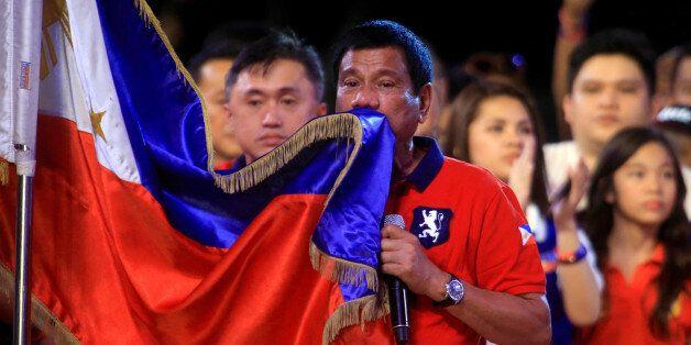 Philippine presidential candidate and Davao city mayor Rodrigo 'Digong' Duterte kisses the Philippine...