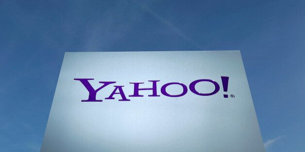 A Yahoo logo is pictured in front of a building in Rolle, east of Geneva, Switzerland December 12, 2012....