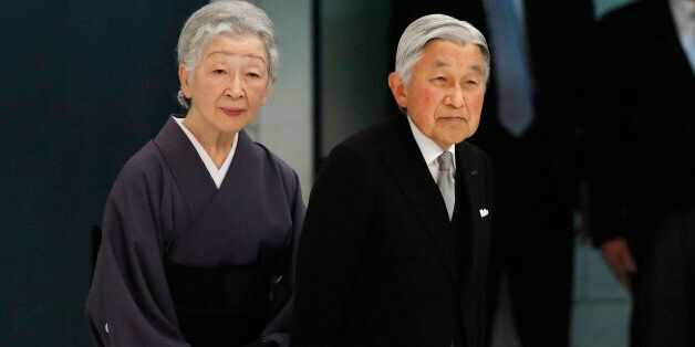 Japan's Emperor Akihito accompanied by Empress Michiko leaves during a memorial service at Nippon Budokan...