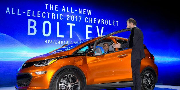 President Barack Obama sits in a new Chevrolet Bolt electric car as he visits the 2016 North American...