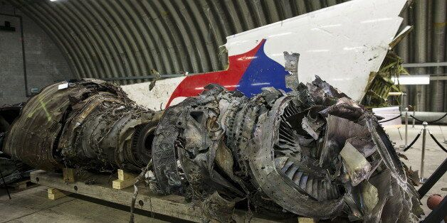 Wreckage of the MH17 airplane is seen after the presentation of the final report into the crash of July...