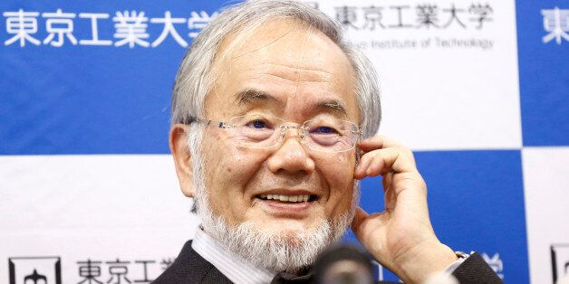Yoshinori Ohsumi, a professor of Tokyo Institute of Technology, smiles during a news conference after...