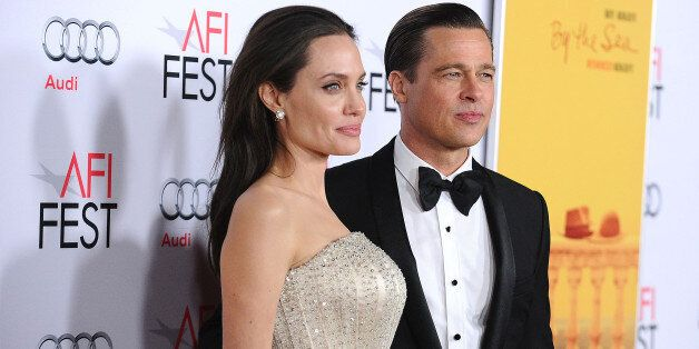 HOLLYWOOD, CA - NOVEMBER 05: Angelina Jolie and Brad Pitt attend the premiere of 'By the Sea' at the...