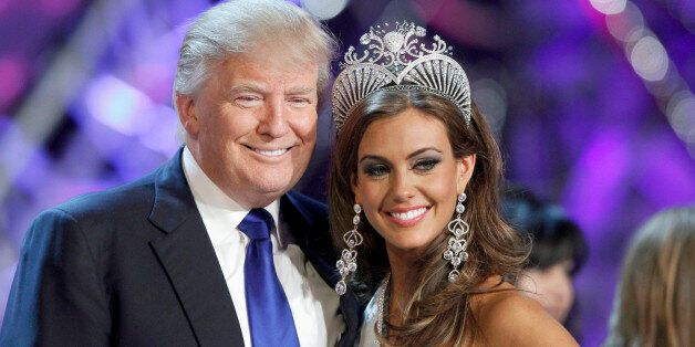 Donald Trump, co-owner of the Miss Universe Organization, poses with Miss Connecticut Erin Brady at a...
