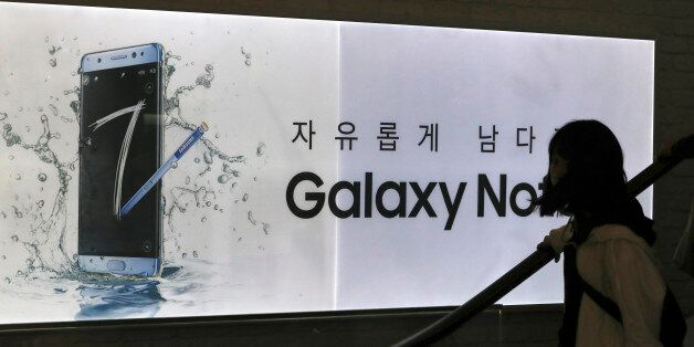 A visitor passes by an advertisement of the Samsung Electronics Galaxy Note 7 smartphone at its shop...