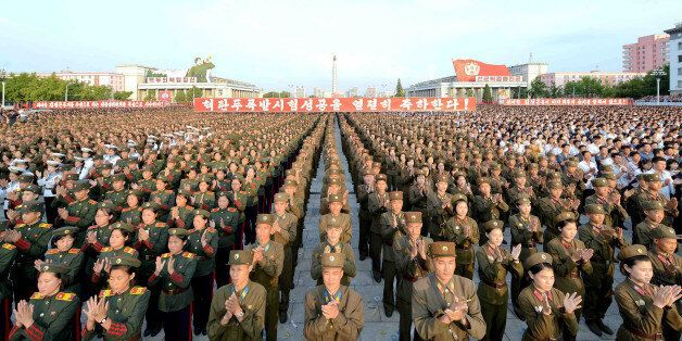 A rally celebrating the success of a recent nuclear test is held in Kim Il Sung square in this undated...