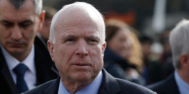 U.S. Senator John McCain arrives on a visit at a migrant center near the village of Adasevci, Serbia...